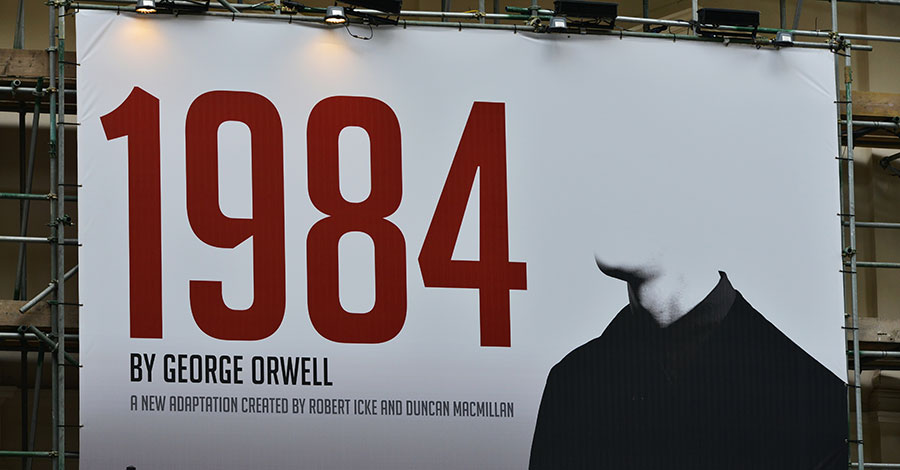 View a billboard advertising Robert Icek and Ducan MacMillan's theatrical adaptation of George Orwell's Nineteen Eighty-Four