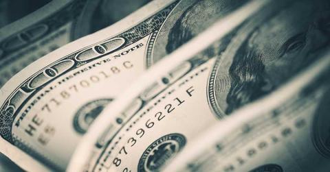 Bild zeigt Dollarscheine - das inoffizielle Symbol des Kapitalismus